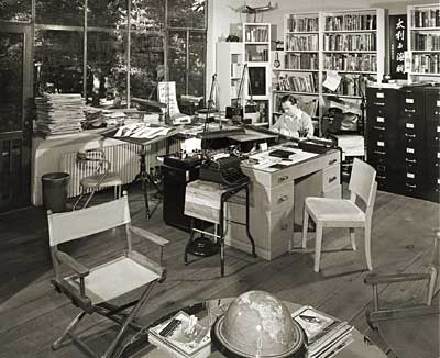 Milton Caniff in his studio